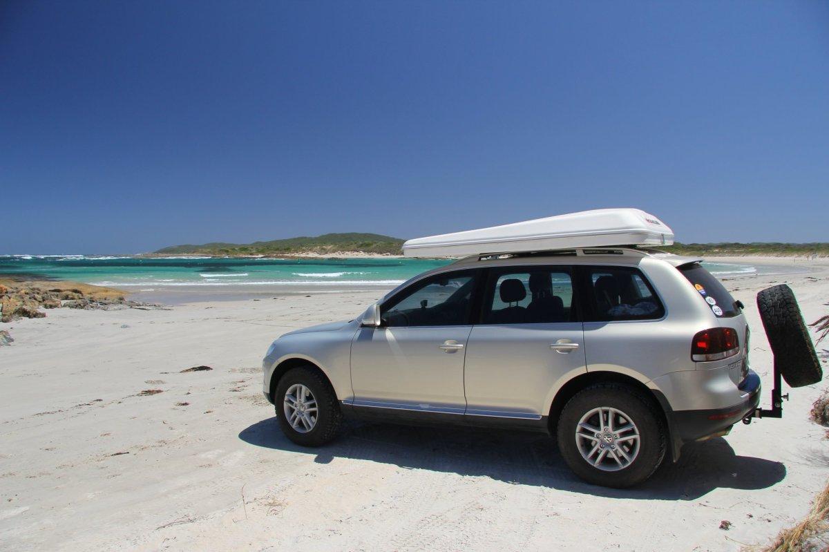Magda sunbaking on the beach, West Australia