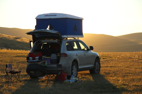 The sun sets in Central Mongolia as we setup camp after a day's driving.