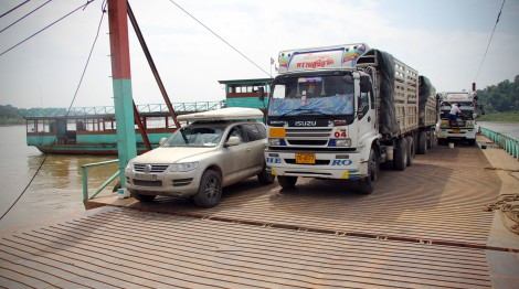 Crossing a border by ferry: Laos to Thailand across the Mekong.  Note how much of the windscreen is covered on the truck, think I'll let him go first...