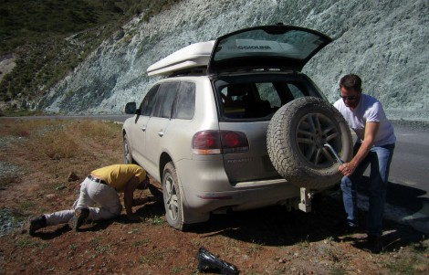 And another tyre bites the dust, this time at Tiger Leaping Gorge, Southern China